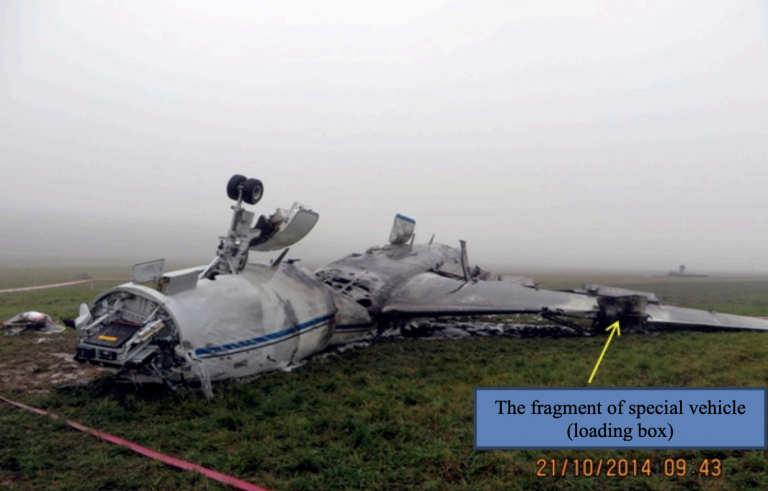 Falcon 50EX upside down after collision with a snowtruck at Mosco Vnukovo airport 10 October 2014